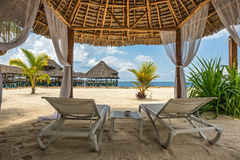 Beach lounges and a beach bar, Zanzibar, Tanzania Royalty Free Stock Image