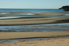 Beach at low tide. Scenic view of sandy beach at low tide Stock Images