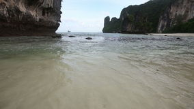 Beach at low tide near the rock stock video footage