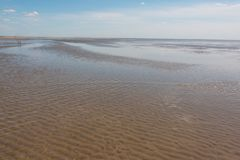 Nordfriesland. Beach at low tide in Sankt Peter-Ording in Nordfriesland, Schleswig-Holstein, Germany royalty free stock image