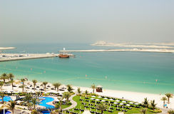 Beach at luxurious hotel. With a view on Jumeirah Palm island, Dubai, United Arab Emirates Stock Photos
