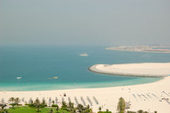 Beach of luxury hotel. And construction of new hotels on Palm Jumeirah man-made island, Dubai, United Arab Emirates Royalty Free Stock Images