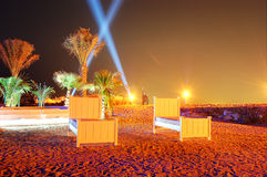 Beach of luxury hotel in night illumination on Palm Jumeirah Stock Photo