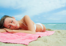 Beach lying girl Stock Images