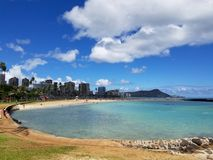 Beach on Magic Island in Ala Moana Beach Park. On the island of Oahu, Hawaii.  Waikiki and Diamond Head in the distance and helicopter in the air on a beautiful Stock Photos