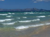 Beach of majorca with clear water and montains on Royalty Free Stock Photo