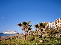 Beach of Malaga with cruise ship Royalty Free Stock Images