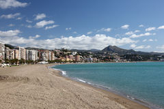 Beach in Malaga, Spain. Beach and waterfront district La Caleta in Malaga, Andalusia Spain Royalty Free Stock Photography