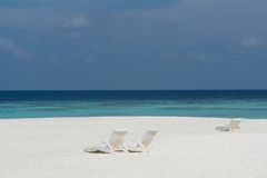 Beach on a Maldive Island. Beach with beach chairs on a Maldive Island royalty free stock images
