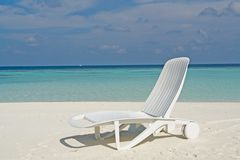 Beach on a Maldive Island. Beach with beach chairs on a Maldive Island stock photos