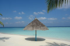 Beach on a Maldive Island. Beach with parasol on a Maldive Island stock photography