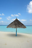 Beach on a Maldive Island. Beach with parasol on a Maldive Island stock images
