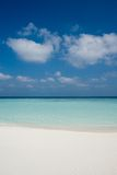 Beach on a Maldive Island. White coral sand beach on a Maldive Island royalty free stock image