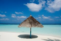Beach on a Maldive Island. Beach with parasol on a Maldive Island royalty free stock images