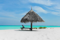 Beach of Maldives. Only umbrella on the beach of Maldives, this is Nalaguraidhoo island. Nice place for hollydays, rest on the  beach and relax Royalty Free Stock Photos