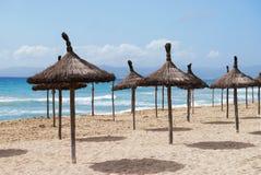 Beach of Mallorca. Beautiful sunny beach with umbrellas in Palma de Mallorca Royalty Free Stock Images