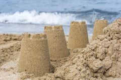Sand forms at a sand castle with sea in the background stock photos