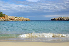 Beach in Mallorca. Waves in a beautiful beach on the island of Mallorca (spain) - Cala Marsal Stock Images
