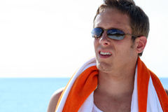 Beach Man. Headshot of man in sunglasses at beach with towel around shoulders Royalty Free Stock Photos