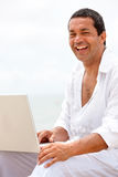 Beach man on a laptop Royalty Free Stock Images