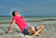 Beach man relaxing Royalty Free Stock Photography