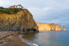 Beach and mansion on the cliff, pierced rock of Perce  Stock Photography