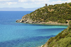 Beach Mare Pintau and Spanish Tower in Sardinia, Italy. Royalty Free Stock Photography