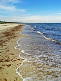 Beach in Marielyst, Denmark - baltic sea. Beach in Marielyst, denmark with ocean waves of baltic sea and blue sky Stock Image