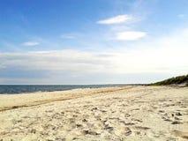 Beach in Marielyst, Denmark - baltic sea. Sandy beach of marielyst, denmark with ocean baltic sea and blue sky Stock Photo