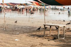 Beach market crowded with tourists and vendors in Mandarmani, west Bengal during new stock images
