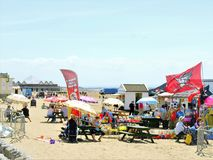 Beach market, Weston-Super-Mare. Weston-super-mare, Somerset, UK. June 21,2010 Holidayamkers enjoying a market on the beach selling a variety of goods at Weston stock photography