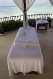 Beach Massage Table. A single massage table by the beach Stock Image
