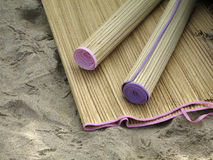 Beach Mats. Detailed view of rattan beach mats in the sand Royalty Free Stock Image