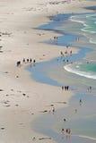 Beach meander. Lazy Sunday beach strollers at Cape Town's Noordhoek Beach Stock Photos