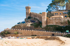 Beach and medieval castle in Tossa de Mar, Spain Royalty Free Stock Image