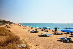 Beach at the Mediterranean Sea near Malgrat de Mar - Costa del Maresme, Spain. Sea water, sand, sky and sun. Happy holiday Royalty Free Stock Images