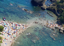 Beach meet Beach. A small strip of land,beach, almost join the small island of Isola Bella with the bigger island of Sicily Royalty Free Stock Photography