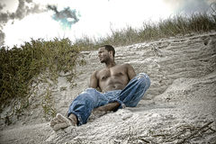 Beach memories. African American man sitting on a beach Stock Photos