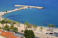 Beach of Menton in France. Aerial view of beach and palm trees of Menton in France, department Alpes Maritimes Stock Photos