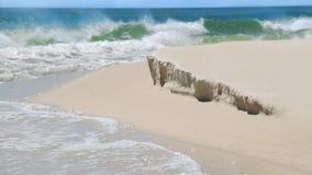 Beach with Mild Sand Dune Erosion. Crashing surf on beautiful beach with mild erosion of sand dune stock image