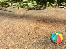 Beach of a miniature world with a lonely ball royalty free stock photography