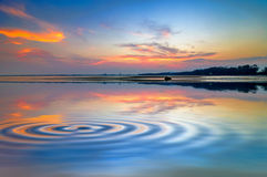 Beach mirrors the sky. At sunset time royalty free stock photo
