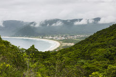 Beach and mist in the mountains Stock Image