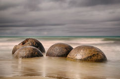 Beach with Moeraki Boulders, New Zealand - long time exposure Royalty Free Stock Image