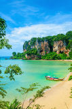 Beach with mogotes and long tail boat, Thailand Stock Photo