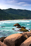 Beach Mole (praia Mole) in Florianopolis, Santa Catarina, Brazil. Beautiful blue water and sky in Beach Mole (praia Mole) in Florianopolis, Santa Catarina Royalty Free Stock Images