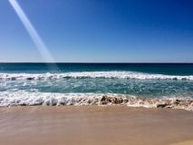 Beautiful summers day at the beach. Beach at Mollymook on a bright summers day Royalty Free Stock Photography