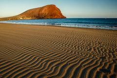 The Beach with Montana Roja hill in background, Tenerife. The Tejita Beach with Montana Roja hill in background, Tenerife, Canary Islands royalty free stock photography