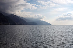 The beach at Monterosso al mare. Sea, mountains and storm cloud Stock Photography