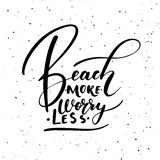 Beach more worry less. Ink brush pen hand drawn phrase lettering design Stock Photo